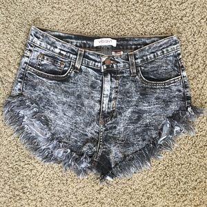 Vibrant MIU high waisted frayed acid wash shorts